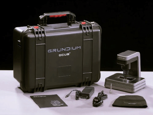 Ocus single slide scanner and accessories, including cord, instruction manual, and carry-on travel case