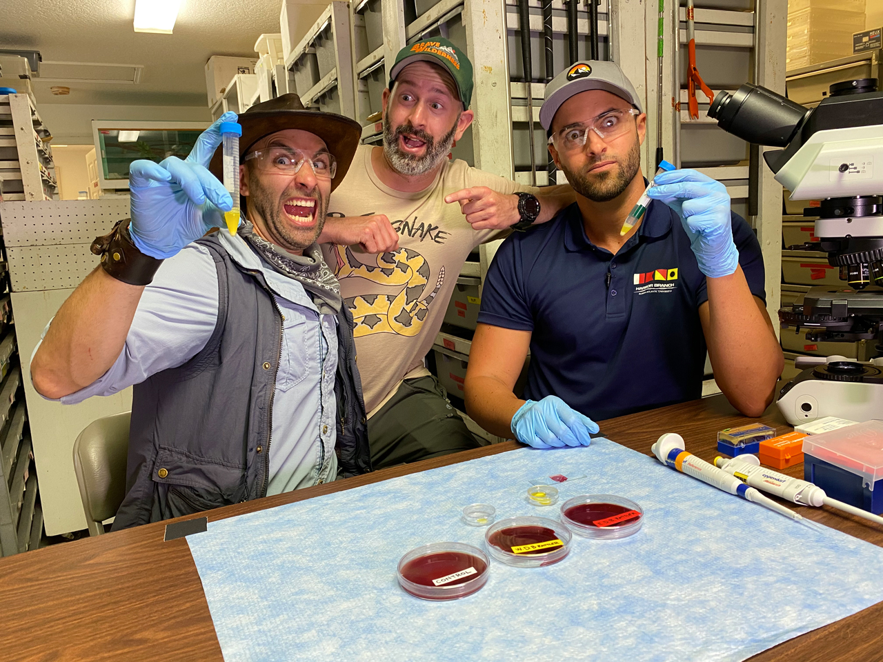 Still from Brave Wilderness YouTube video on mixing snake venom and human blood under the microscope starring Coyote Peterson, Mario Aldecoa and Dr. Hunter Hines